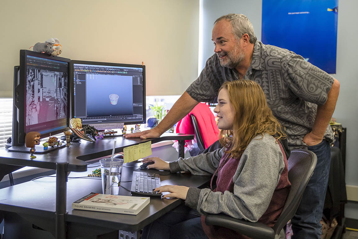 Howard Cook helping student in animation